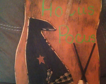 Handmade wooden primitive pumpkin with witch hat and brooms