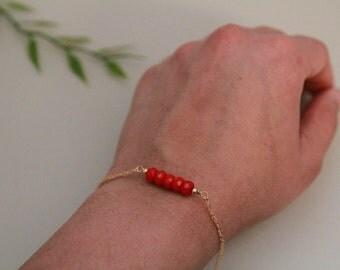 Coral wirewrapped 14 k gold bracelet