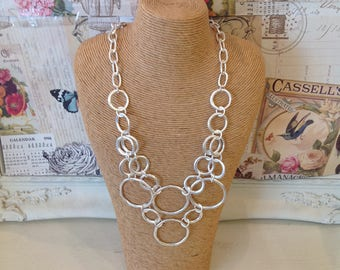 Silver coloured  necklace with circular link detail