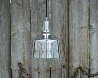 Cool retro styled Modernist hanging light made from polished aluminium with brass B22 bulb holder CMSR4