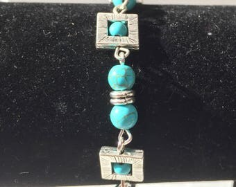 Turquoise beads bracelet with Tibetan silver squares.