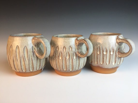 Hand-carved contemporary-classic pottery mug,