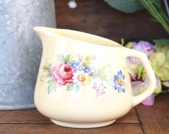 Small vintage,  ceramic jug, creamer or pitcher with traditional pretty floral motif on a cream ground
