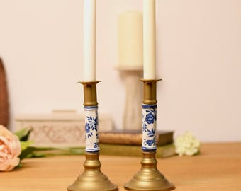 Pair of vintage brass candlesticks inset with blue and white ceramic stem