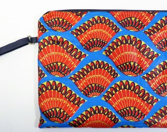 Blue and red clutch bag with leather strap