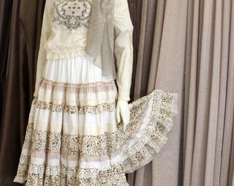 Romantic beige light color mini dress in boho chic style.