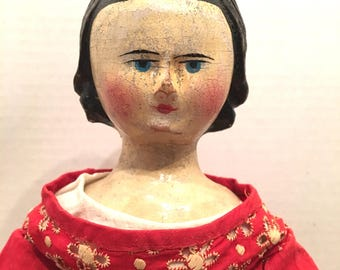 Rare early 19th cen hand carved all wooden doll. Madeline Merrill collection
