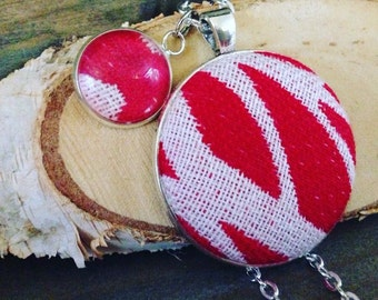 Pendant (inc chain) made from Solnce wrap scrap woman in red.