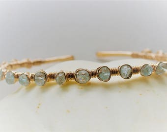 a 14ct gold fill cuff bracelet wire wrapped with aquamarines