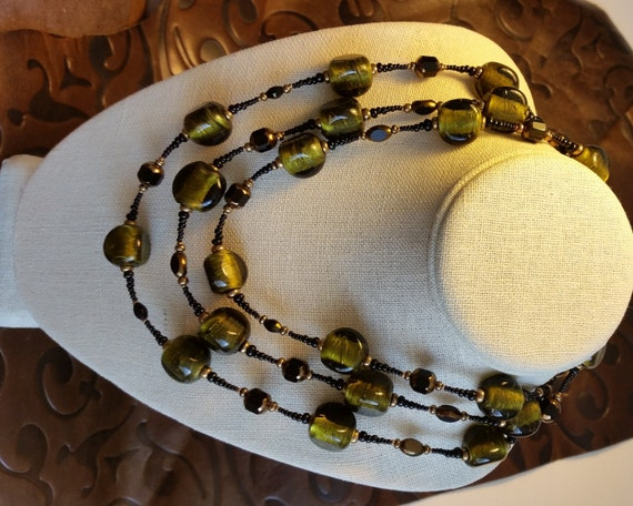 "LONG 58"" OLIVE SILVERFOIL Bead Necklace to Wrap Around. Peridot Green with Black and Gold Faceted Glass Beads. Brass Clasp. Layered."