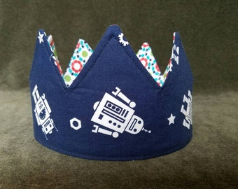 """21"""" reversible and adjustable fabric crown for kids and adults. Robots on blue with abstract flowers on reverse."""