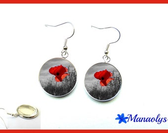 Earrings poppies on bottom in black and white, glass cabochons