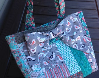 Handmade quilted tote bag with bow