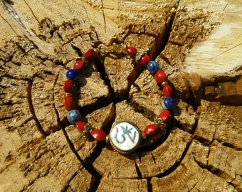 Lapis Lazuli and Bodhi Beads with Tibetan Conch Shell Bead Bracelet