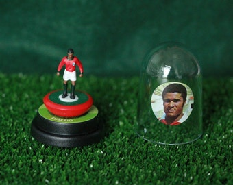 Eusebio (Portugal) - Hand-painted Subbuteo figure housed in plastic dome.