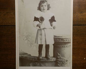 Rare Antique cabinet card child holding a rattle toy or lollipop