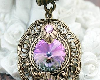 Vintage oxidized brass swarovski pink pendant