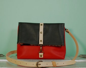 Pumpkin and black leather fold over bag with cotton lining, 24x18 cm and a zipper pocket
