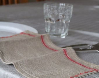 napkin made from antique linen with red floral seam