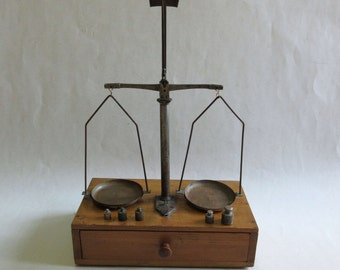 antique apothecary balance scales, with 5 weights