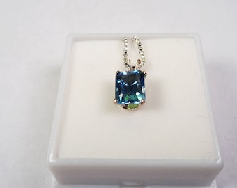 Natural 8 x 6mm. London Blue Topaz Silver Pendant on a 24 inch Chain.