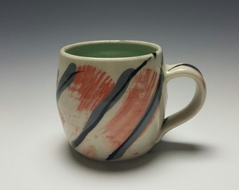 Handmade ceramic mug with coral brush strokes by Potteryi