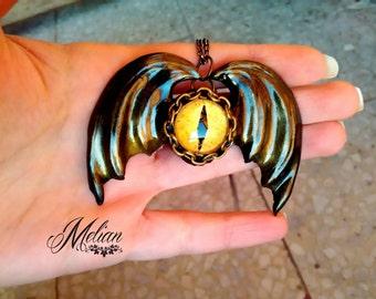 Winged eye necklace