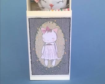 Miniature cat plushie soft toy in a box/bed