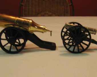 Collectible Vintage Cannons Brass and iron Great Decoration One is A lighter the other made in Italy as a toy