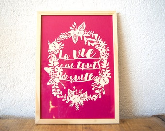 Wooden frame with illustration in paper cut - text and frame of flowers - mantra - life is immediately