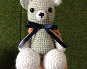 Grey and white teddy bear