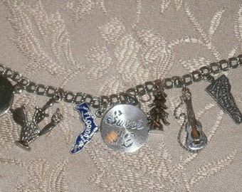 Sterling Silver Eight Charm Bracelet