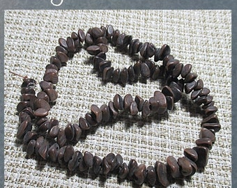 """BURI PLANT SEED beads - natural color - 1/4 crescent slices - 15"""" strand"""