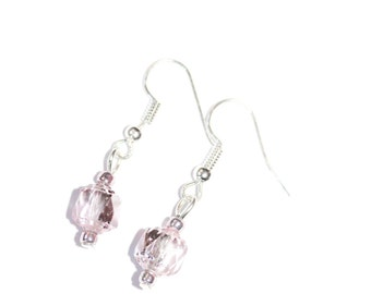 Earrings with silver ear wires and light pink glass beads