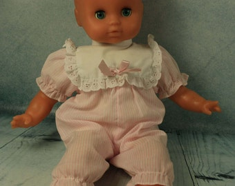Vintage interactive Vinyl baby doll who cries and laughs when her tummy is pressed