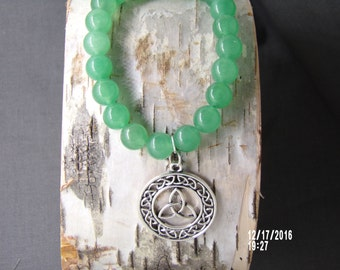 B1267 Small Jade Glass Beaded Bracelet with Celtic metal Charm.