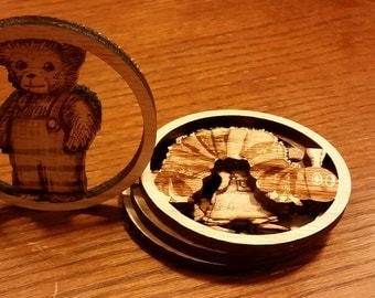 Wood coasters/ornaments featuring characters from the BFG, Corduroy, Giving Tree, and Where the Wild Things Are children's books