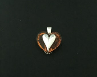 Amber heart pendant, amber heart slab topped with a sterling silver heart