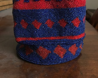 Bag embroidered with red and blue coral