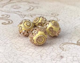 Qty4 15mm Indonesian Beads, Handmade Beads, Pale Yellow With Gold Toned Metal Alloy Embellishments