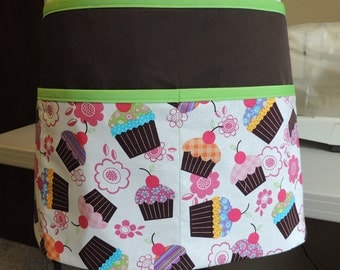 Cute multi-purpose apron with cupcakes, brown background, and green accents