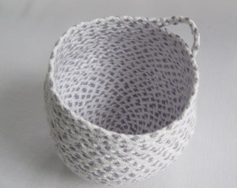 Coiled cotton cord basket.