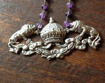 Majestic lions and a crown necklace with amethyst rosary beads.