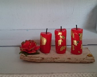 Miniature polymer clay red candles with golden details and red rose