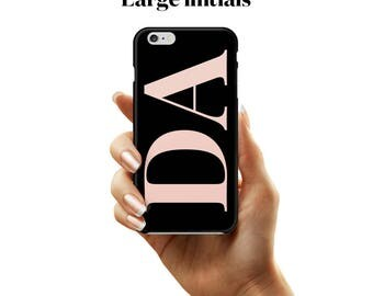 Large initial case in a black and pink combination. A phone case for iPhone and Samsung Galaxy devices.