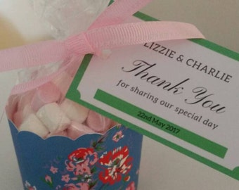 Personalised wedding favour, ribbon tied cellophane sweet bags in a pretty flower design case. Beautiful design, perfect gift.