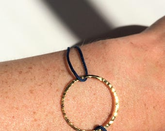 Gold plated circle on a sliding knot bracelet