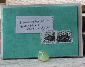 A trout in the pot is better than a salmon in the sea.. Card with handwritten text and Swedish postal stamps