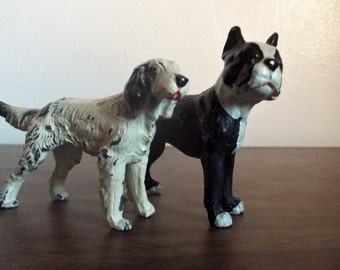 Pair of Vintage Cast Iron Dog Figurines Black and White Boxer and White Irish Setter