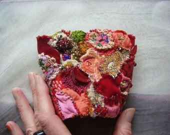 warmth - a delicate hand embroidered collage wrist cuff in red